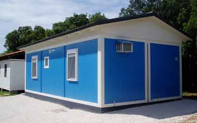 Vacation house on camp site made from containers